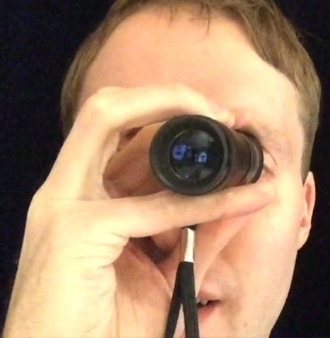 Me using my monocular (a mini telescope) to see things in the distance.