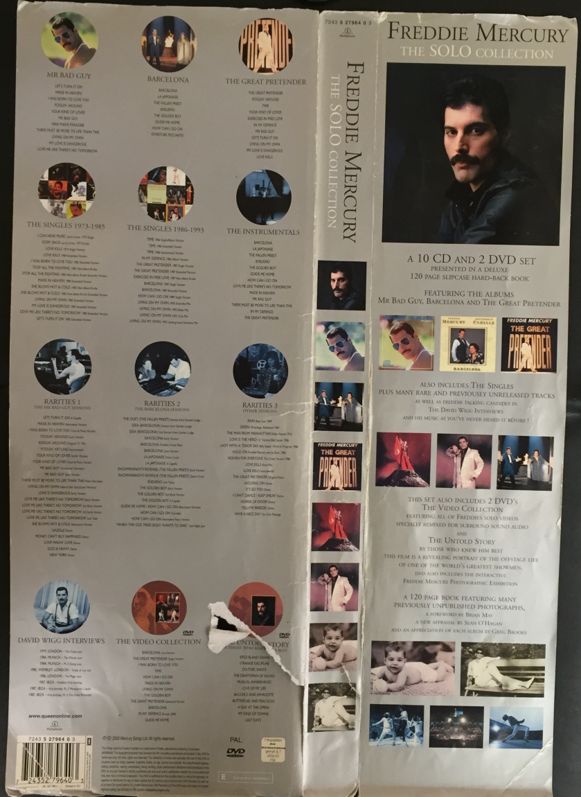 Paper sleeve that goes around the Freddie Mercury Solo Collection Boxset. Lists the contents of the 10 CDs and 2 DVDs in the set, with images of the artwork for the discs and albums. The set also includes a huge 120-page hardback book.