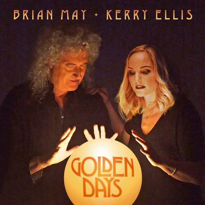 Album cover for Golden Days. Brian May and Kerry Ellis stand next to each other, their hands held over a large golden ball has the text Golden Days in the middle. Brian and Kerry's names are above their heads at the top of the cover.