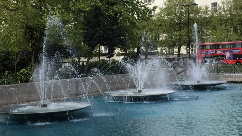 3 large fountains next to each other.