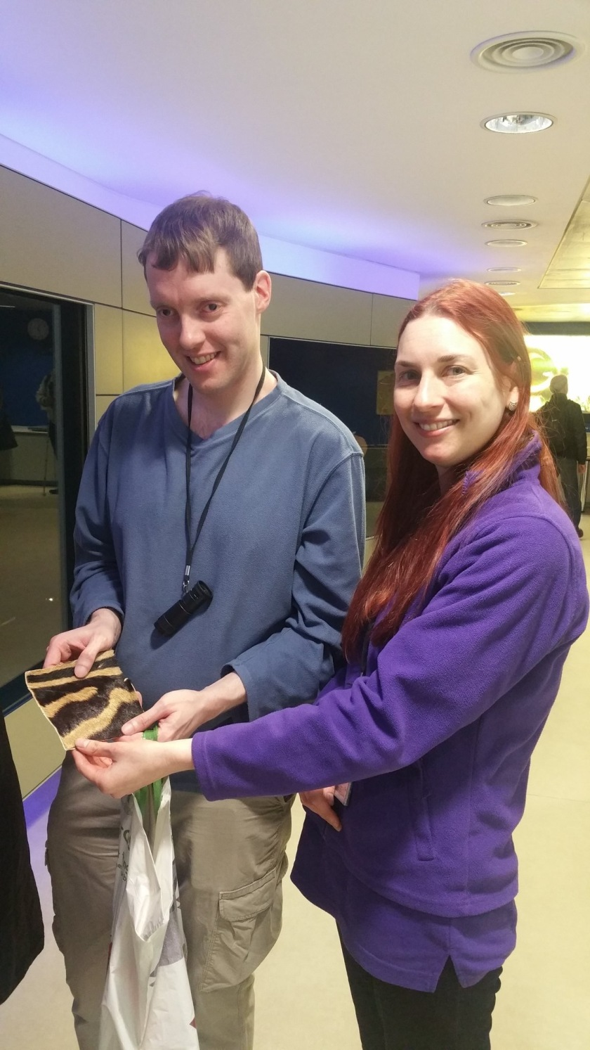 Glen holding a square piece of zebra fur with Sarah, one of the guides at the Natural History Museum.
