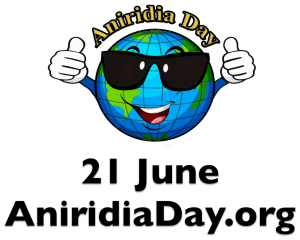 "The Aniridia Day logo is a cartoon style image of the Earth, wearing sunglasses, smiling and giving a double thumbs up. Curving over the top, in yellow text with black outline, are the words ""Aniridia Day"". Below the Earth in bold black text is 21 June, and below that the address for aniridiaday.org."