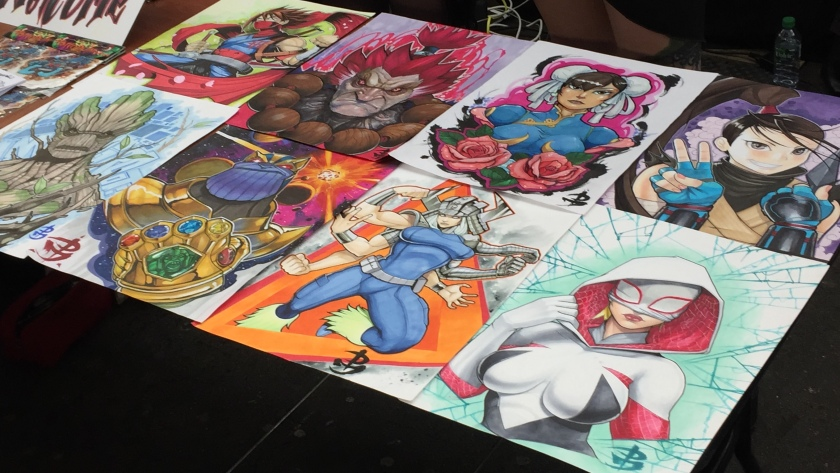 Table laid out with anime inspired tattoo designs