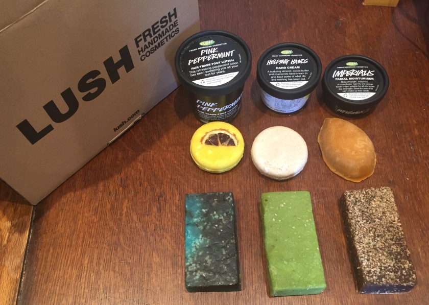 9 Lush products - 3 tubs, 2 round soaps, a pumice stone shaped soap, and 3 rectangular soap bars.