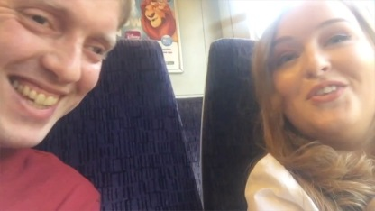 Myself and Emily smiling as we sit next to each other chatting on the train.
