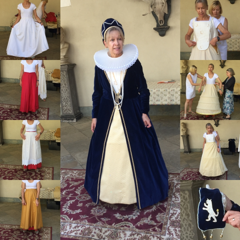 Lady dressed in a tudor outfit, with a long dark blue velvet robe that spreads outwards at the bottom to reveal a cream coloured skirt. There is a large ruff around her neck. 2 columns of 4 smaller images on each side show the various layers that make up the outfit.