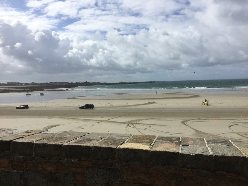 Cars racing in a circuit on the beach in Guernsey