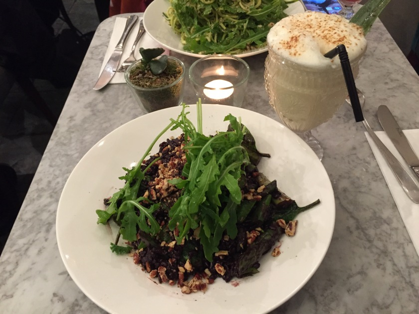 My large plate of asparagus & spinach black rice risotto, with a frothy white coconut and pineapple pina colada cocktail