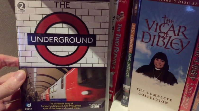 DVD entitled The Underground. 2-disc set, as shown on the BBC. Described as the incredible story of London Underground, told through the eyes of the people who work there. Cover shows the Underground logo in the top half, and a Tube train on the platform in the lower half.