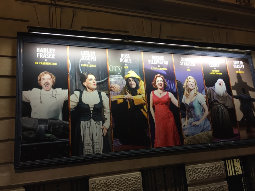 Poster of Young Frankenstein cast on theatre building, with Hadley Fraser, Lesley Joseph, Ross Noble, Dianne Pilkington, Summer Strallen, Patrick Clancy & Shuler Hunsley