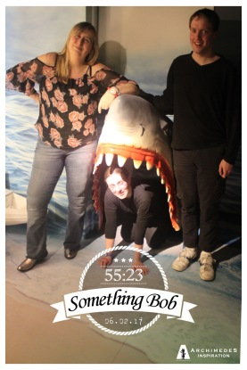 Myself a lady standing beside a model of a shark head by the wall. The other guy in our group is crouched down inside the shark's gaping mouth. A graphic at the bottom shows our team name - Something bob - with a time of 55 minutes and 23 seconds, and the date of February 6th 2017.