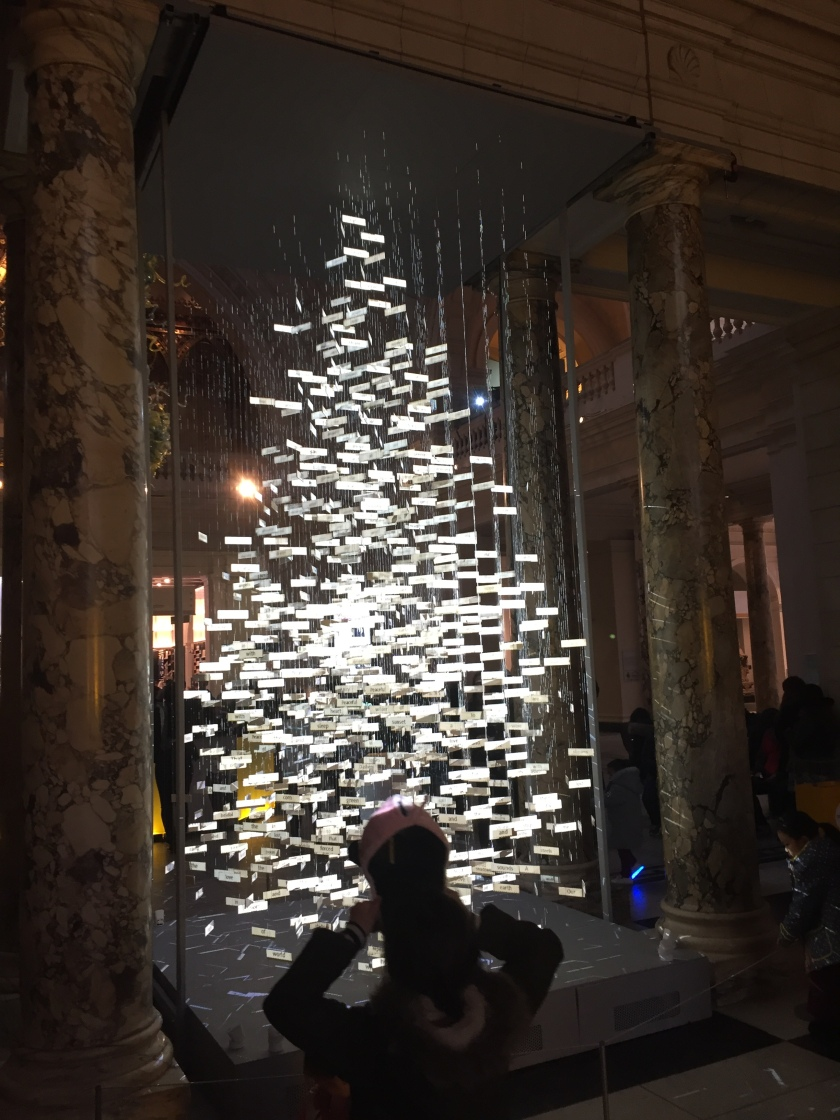 A Christmas tree formed from hundreds of small white rectangular panels, which appear to be floating because of the gaps between them.
