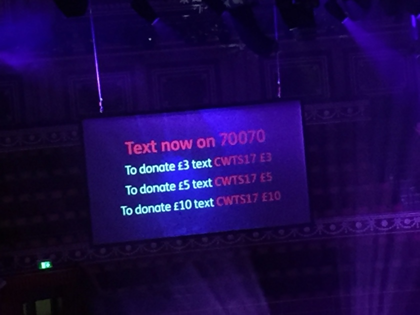 Text donation information for Bloodwise on video screen. Text 70070 with CWTS17, followed by £3, £5 or £10.