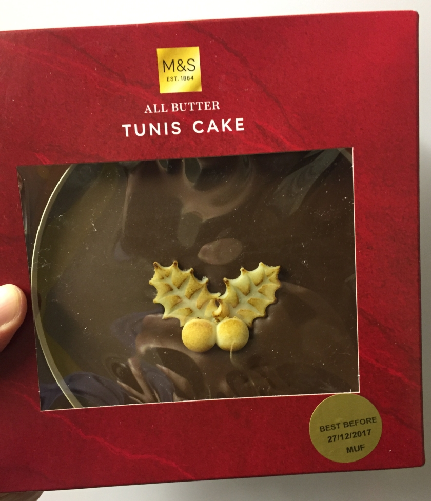 Tunis cake from Marks & Spencer - madeira sponge with a thick chocolate layer on top, and a marzipan holly decoration in the centre.
