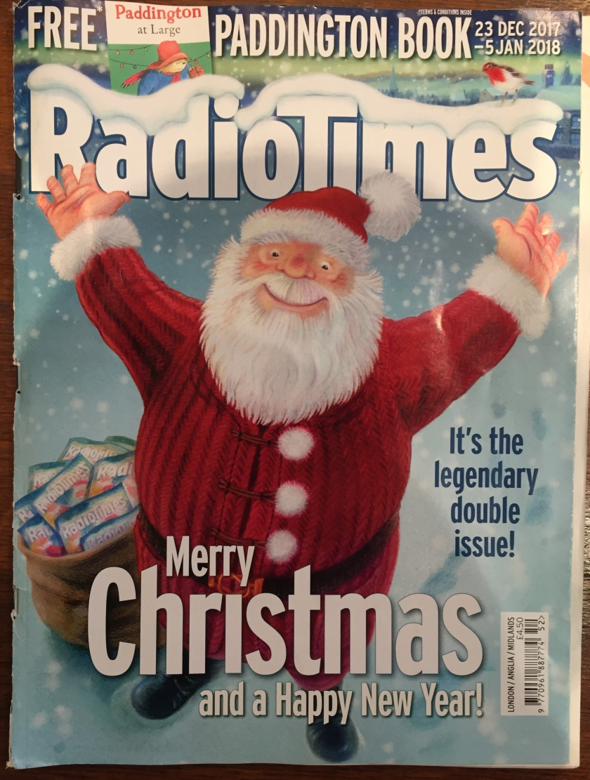 The Christmas edition of the Radio Times magazine, with a cover picture of Santa Claus smiling and holding up his arms in celebration, above the text Merry Christmas and a Happy New Year