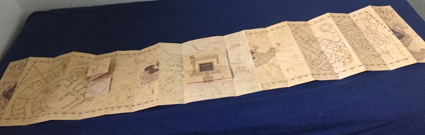 The Marauder's Map of Hogwarts, fully unfolded so that it takes up the length of my bed.