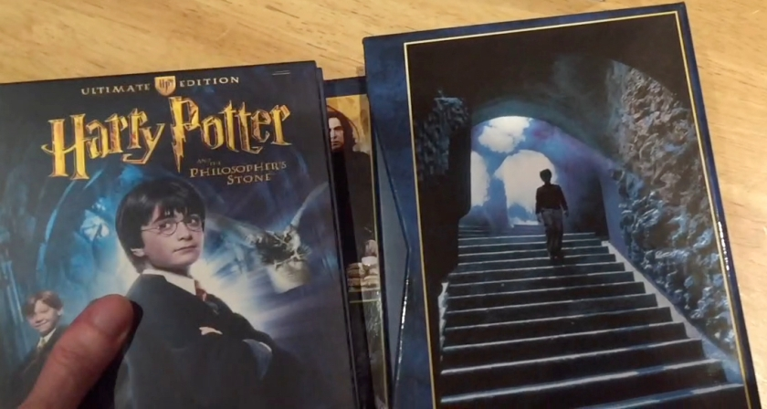 Inside of the Harry Potter Ultimate Edition box set, featuring pictures of Harry posing and walking down some stairs.