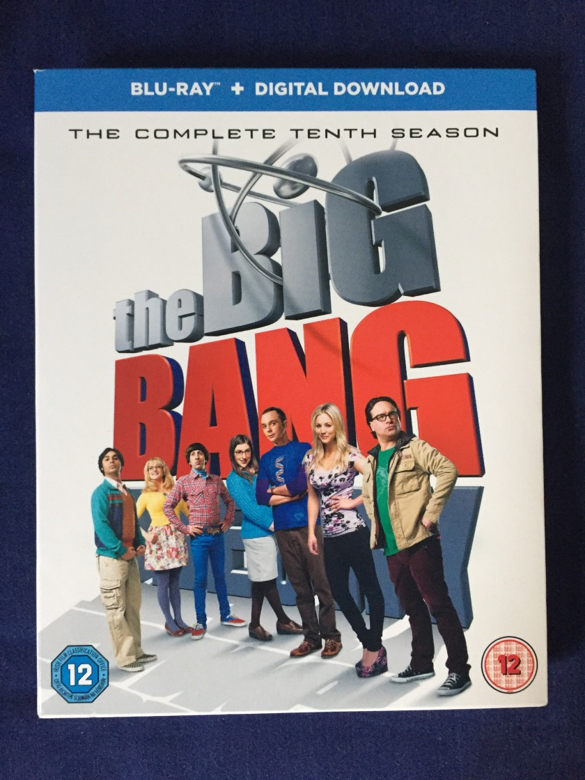 Blu-ray case for The Big Bang Theory, the complete 10th season. Shows the gang standing in front of the huge logo for the show, against a white background.