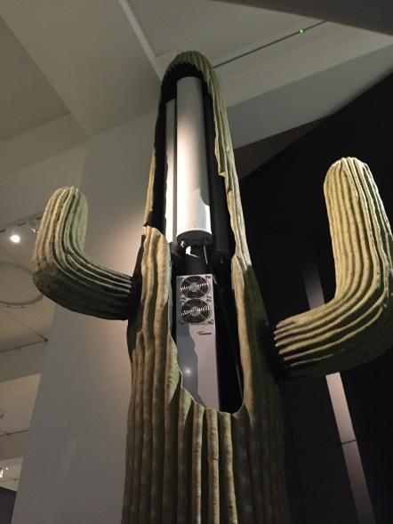 A huge, tall model of a cactus, with the central tower cut open to reveal machinery inside for a mobile phone mast.