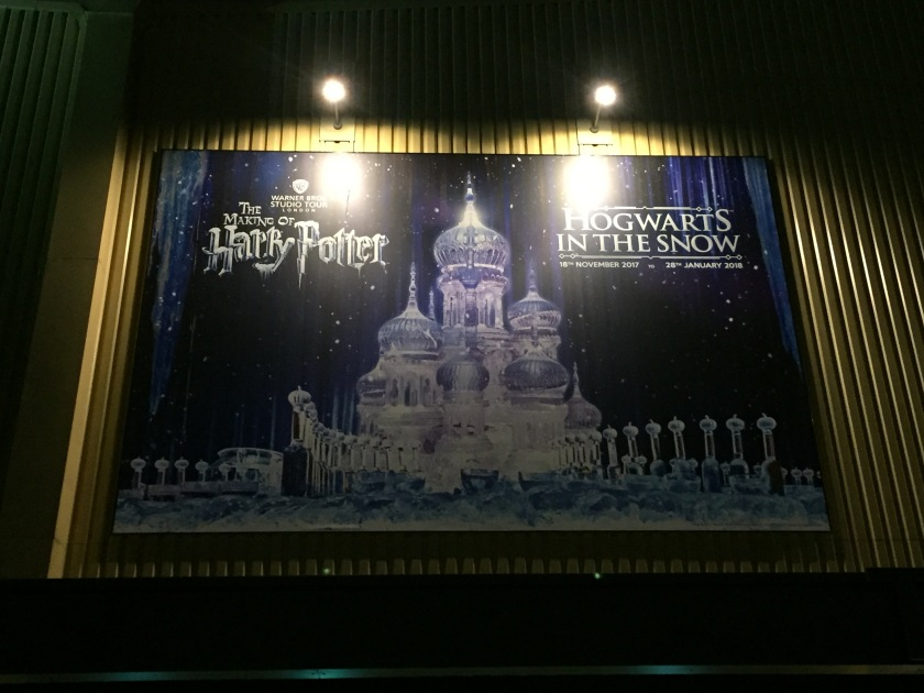 Poster of a big ice castle sculpture in front of a starry night sky. The top left of the poster has the Making Of Harry Potter Logo, while the top right has the text Hogwarts In The Snow.