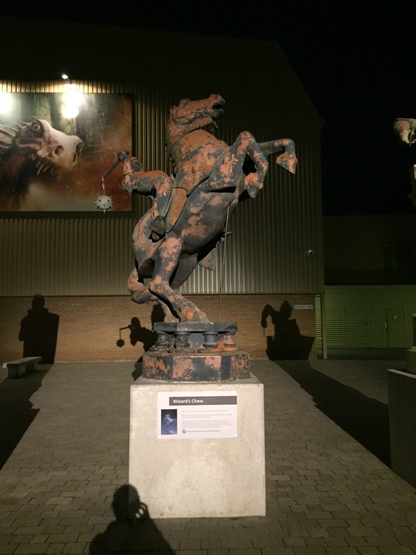 Statue of a horse rearing up on its back legs.