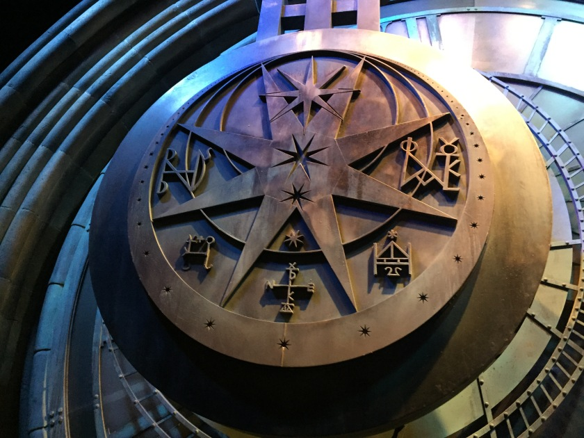 Huge round metal pendulum engraved with star motifs of various sizes.