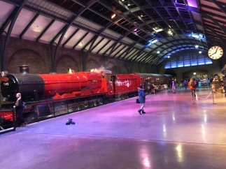 Platform 9 and 3 quarters, with the red Hogwarts Express steam train.