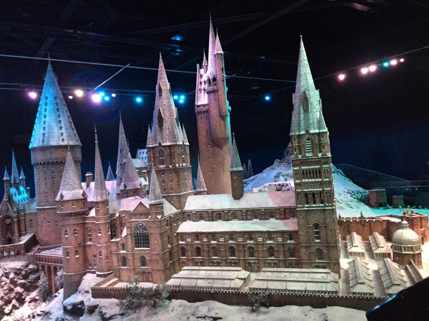 Huge and highly detailed model of Hogwarts Castle, covered in a light dusting of snow.