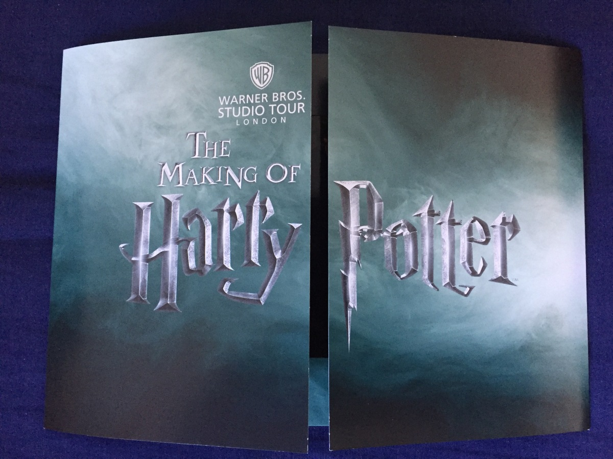 Cover of the card sleeve for the photo, showing the left and right flaps almost closed in the centre. The case has a background looks like a stormy sky, with grey and silver colours, on top of which is the logo for the making of Harry Potter, with the word Potter on the right flap.