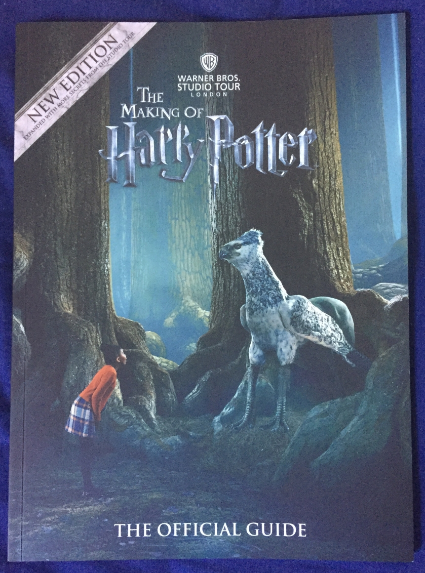 The Making Of Harry Potter Official Guide Book. Cover shows a scene in the Forbidden Forest, with a young girl looking up at Buckbeak the Hippogriff in front of her, as if talking to him.