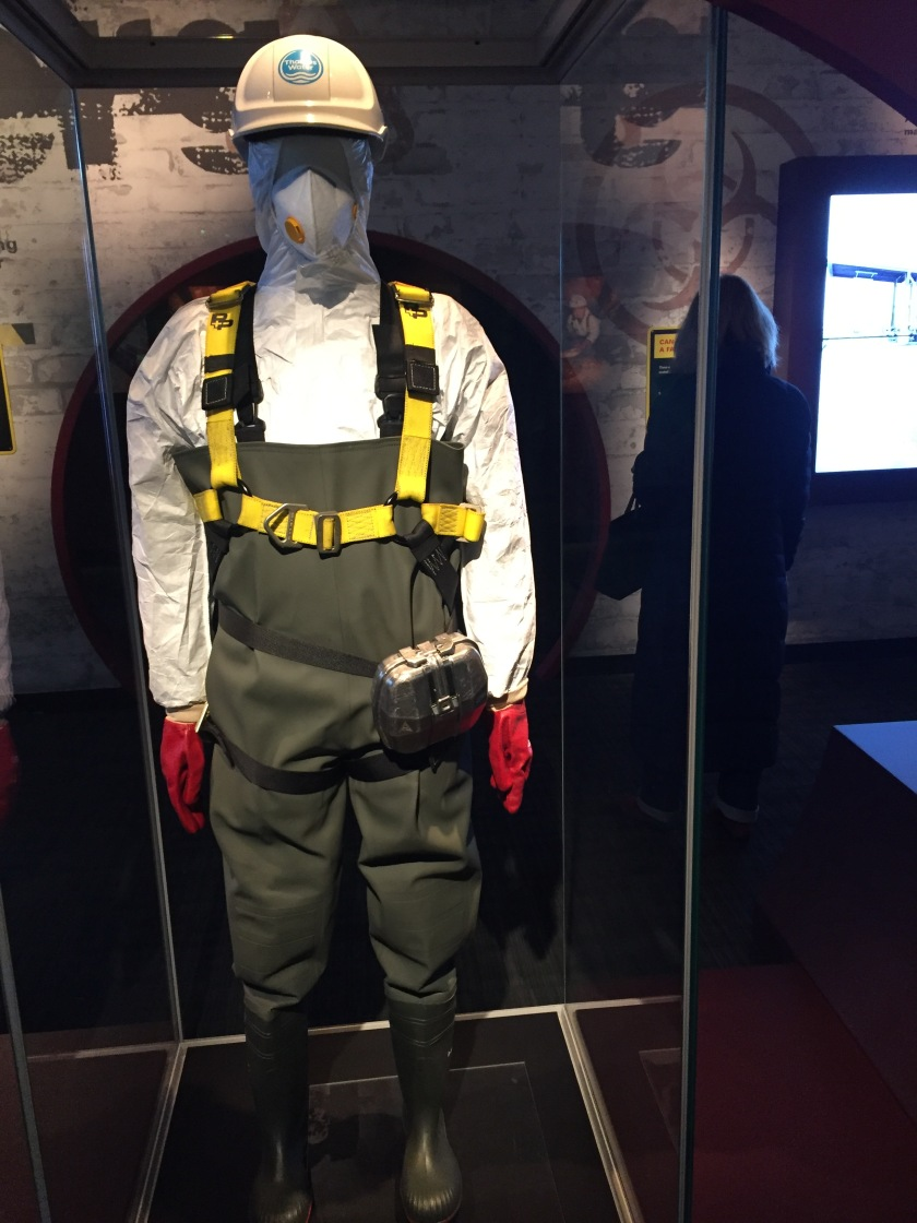 Mannequin wearing protective helmet, face mask, boiler suit and gloves, to protect the workers from harmful toxins when dealing with the Fatberg.
