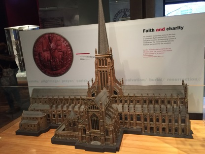 The original St Paul's Cathedral, looking like a long abbey or church with a tall spire in the centre instead of the domed roof we know today.