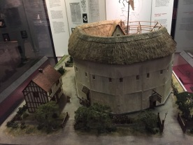 Model of the Rose Theatre, a large white round structure with a thatched roof. It looks similar to the Globe Theatre.