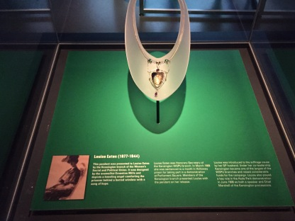 Gold coloured pendant presented to suffragette Louise Eates