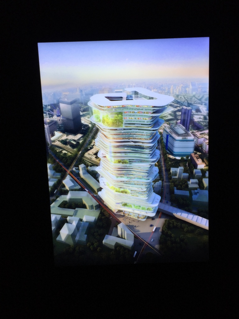 Artist's vision of a an unusual skyscraper in future London. The tall building has an unusual shape, curving in and out irregularly all the way around, and is made up of lots of very thin floors, as if it's a big pile of papers.