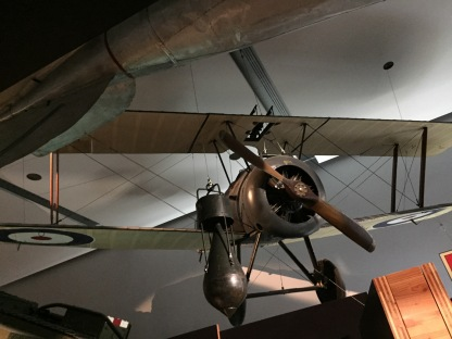 Sopwith Camel plane suspended from the ceiling overhead.