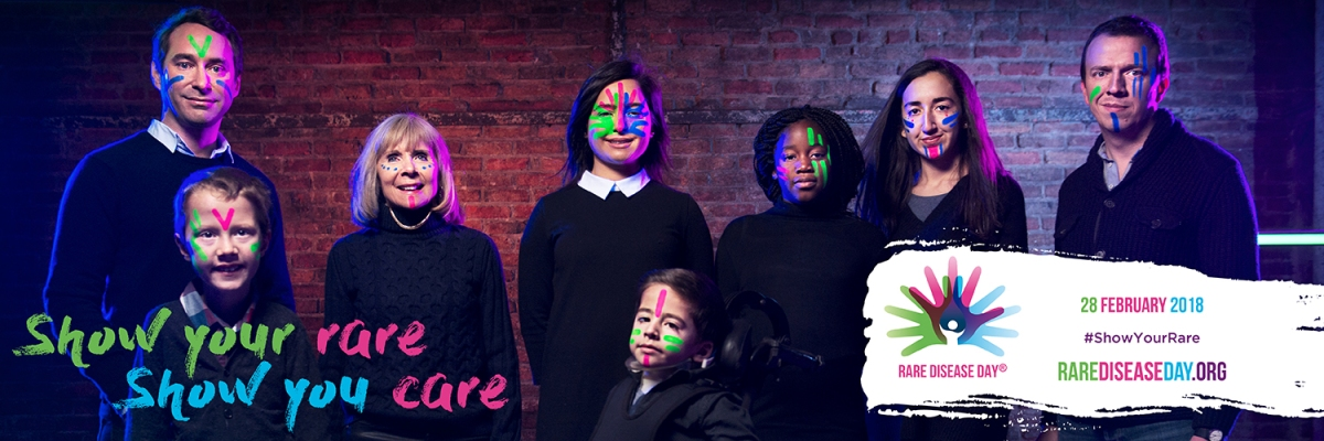 A group of 8 people, of varying age, gender and race, wearing luminous face paint. In the bottom left corner are the colourful words Show Your Rare, Show You Care. On a white banner in the bottom right corner is the Rare Disease Day logo, and colourful text saying 28 February 2018, Show Your Rare, RareDiseaseDay.org.