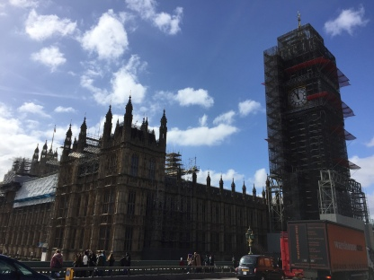 Big Ben & The Houses Of Parliament, with Big Ben's tower covered in scaffolding, leaving only the clock face showing through.