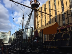 The tall mast of the Golden Hinde, the ship Sir Francis Drake sailed on.
