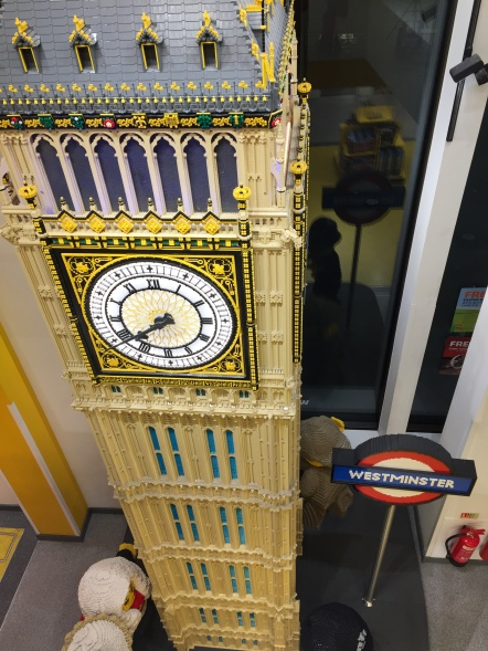 Very tall Lego model of Big Ben, with a Westminster Underground sign next to it.