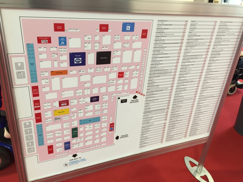 Noticeboard with a floor plan of the exhibition, and a list of exhibitor names with their stand numbers.