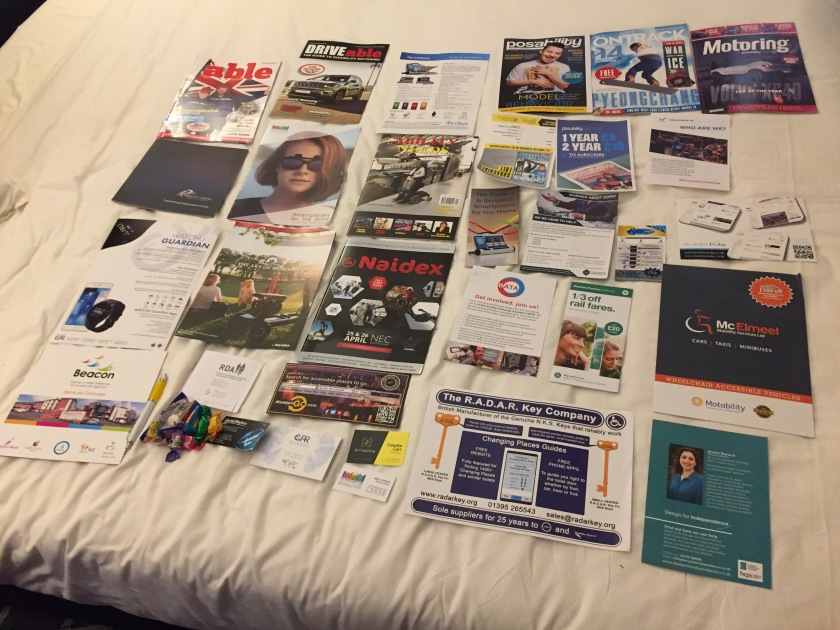 Lots of magazines, leaflets, flyers and business cards from the Naidex show spread all over my hotel bed.