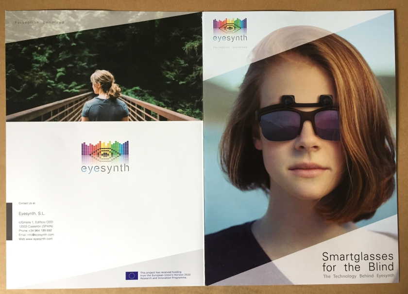 EyeSynth leaflet, with a lady on the cover wearing the dark glasses, which appear to have tiny cameras just above the lenses.