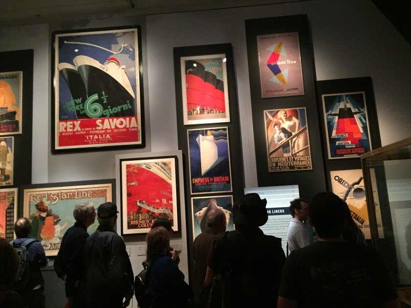 Colourful and artistic posters promoting cruise liners in various languages.