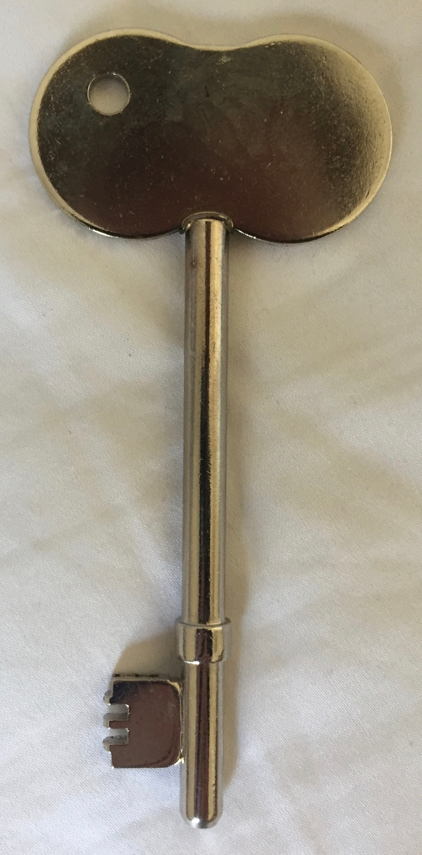 A RADAR key, which is just a large silver key with a large rounded head.