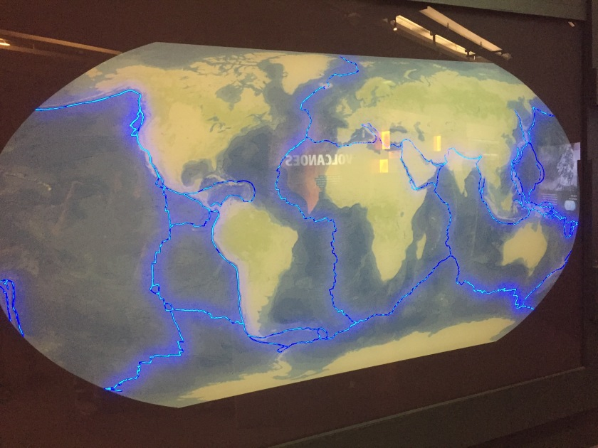 Map of the world, with the edges of the tectonic plates that make up Earth's surface highlighted in blue.