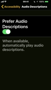 iPhone screenshot showing the option to prefer audio descriptions, which will play them automatically when available.
