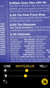 iPhone screenshot of the Magnifier app. It is being used to read the schedule for Channel 4 in a TV guide magazine, using a colour setting that gives white text on a blue background.