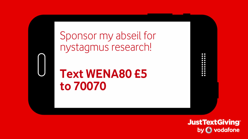 A image of a black smartphone against a red background. The white screen of the phone, on its side in landscape mode, has red text saying Sponsor my abseil for nystagmus research! Text WENA80 £5 to 70070. In the bottom right corner of the red background is a credit for Just Text Giving by Vodafone.
