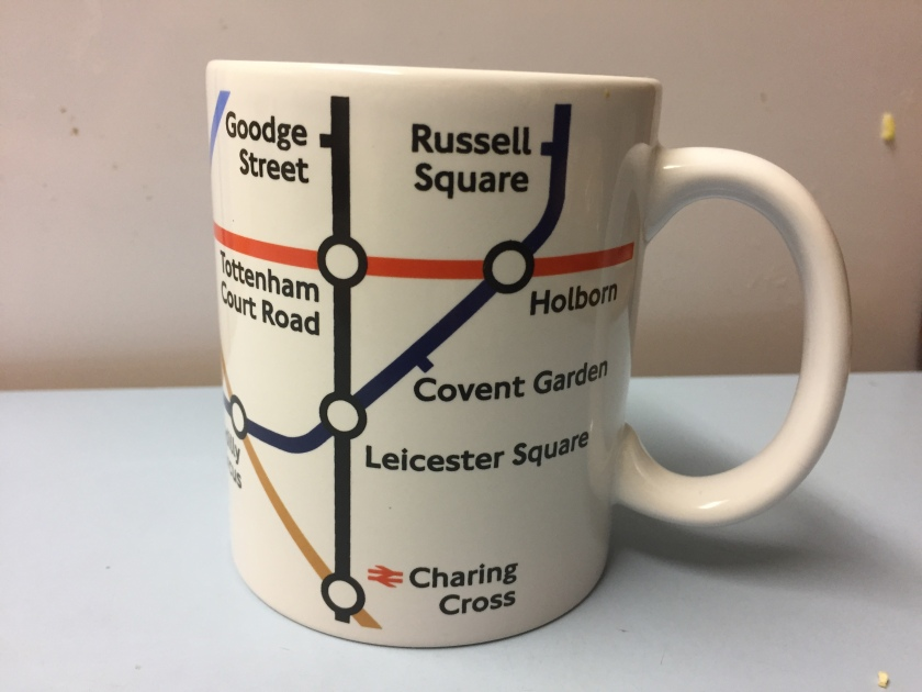 Mug featuring a section from the central part of the Tube Map. On this side of the mug you can see Goodge Street, Russell Square, Tottenham Court Road, Holborn, Covent Garden, Leicester Square & Charing Cross.